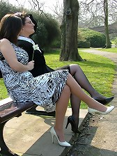 Gorgeous brunettes posing outdoors and showing off their nylons